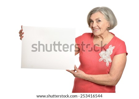 Portrait of senior woman in red dress with white poster on white background - stock photo
