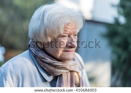 Portrait of senior woman, outdoors