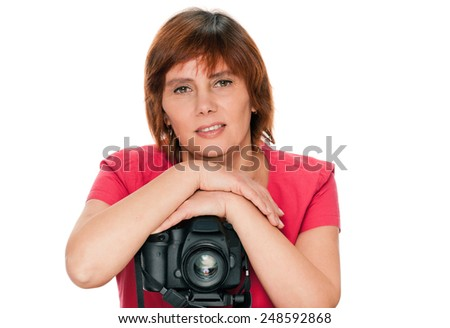 Portrait of senior woman portrait with camera. isolated over white background - stock photo