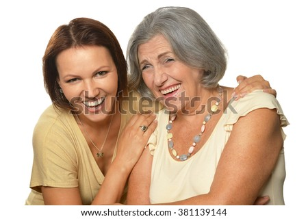 Portrait of Senior woman with daughter on white background - stock photo