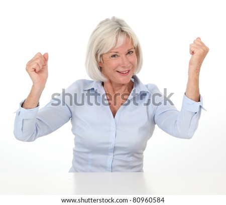 Portrait of senior woman with successful expression - stock photo