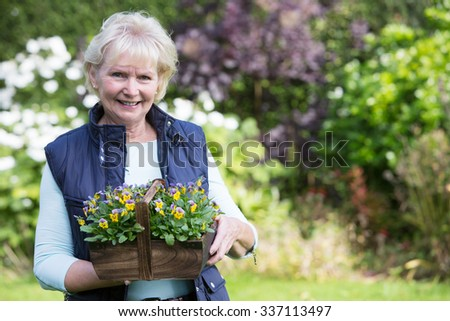 Portrait Of Senior Woman Working In Garden