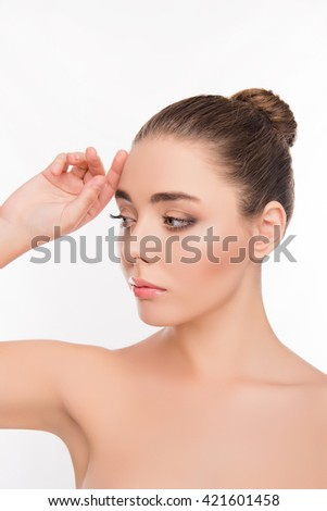 Portrait of sensitive young woman with perfect skin - stock photo