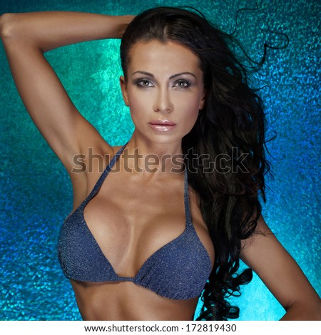 Portrait of sensual brunette woman looking at camera. - stock photo