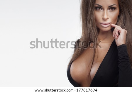 Portrait of sensual brunette young woman with long hair and perfect makeup. - stock photo