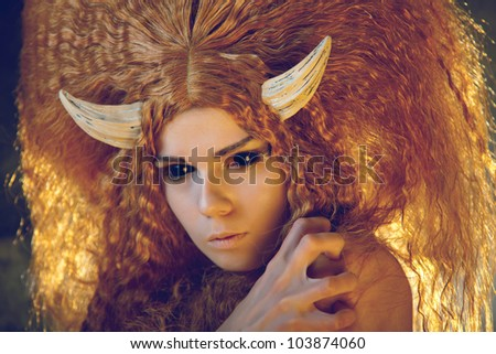 Portrait of sensual female demon with red hair and black eyes - stock photo