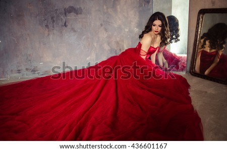 portrait of sensual woman in a long gorgeous red dress