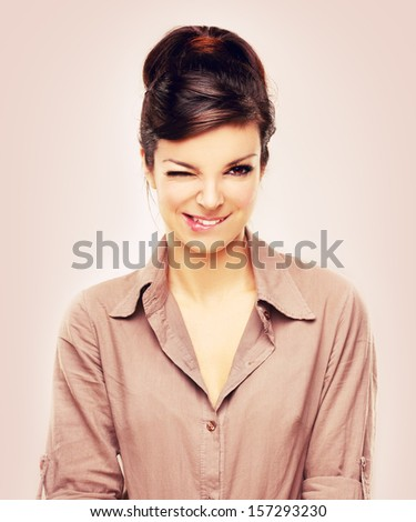 Portrait of sensual young woman biting her lips. - stock photo