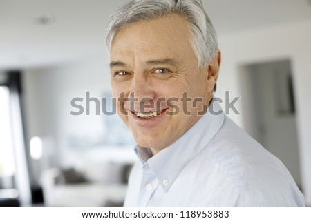 Portrait of serene senior man looking at camera