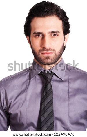 portrait of serious and confident businessman, close up of a serious young businessman