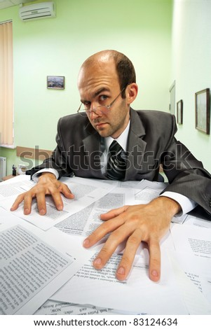 Portrait of serious businessman working in office - stock photo