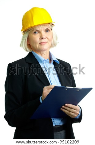 Portrait of serious businesswoman in helmet looking at camera