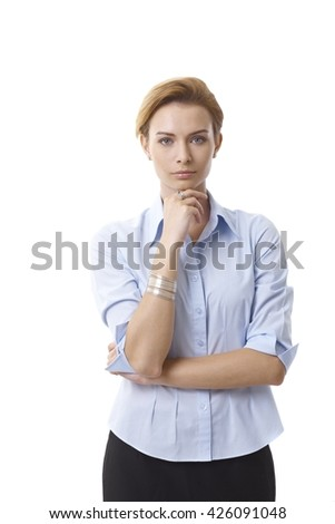 Portrait of serious businesswoman standing hand on chin, looking at camera. - stock photo