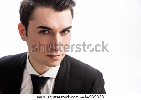 Portrait of serious caucasian businessperson looking at the camera, dressed in suit and isolated on white background - stock photo