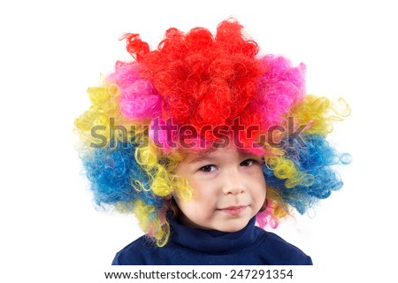 Portrait of serious child with clown wig isolated on white - stock photo