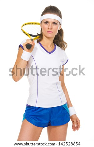 Portrait of serious female tennis player - stock photo
