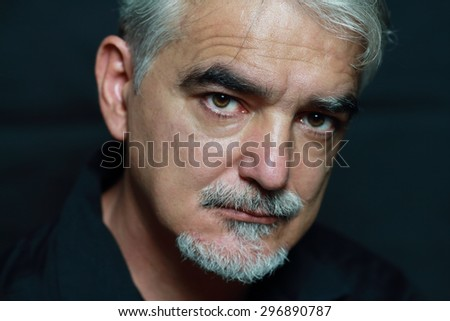 Portrait of serious man ,on dark background