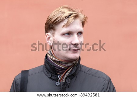 Portrait of serious man on the red background - stock photo