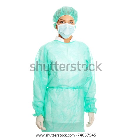 Portrait of serious nurse or doctor in surgical mask - stock photo