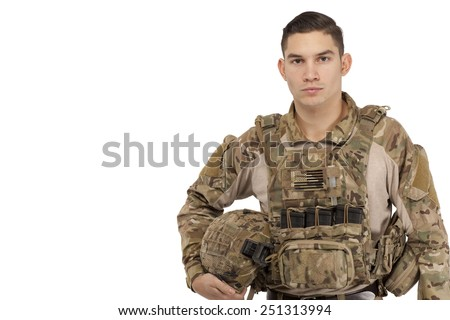 Portrait of serious soldier posing against white background - stock photo