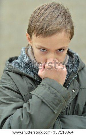 Portrait of serious thinking boy with hand on face
