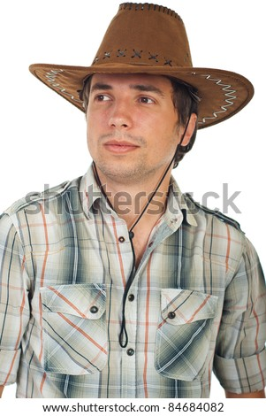 Portrait of serious young cowboy with hat looking away isolated on white background