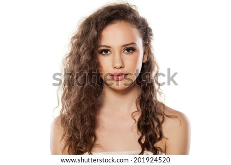 portrait of serious young girl - stock photo