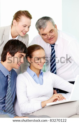 Portrait of several colleagues working through internet in office - stock photo