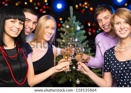 Portrait of several friends celebrating Christmas - stock photo