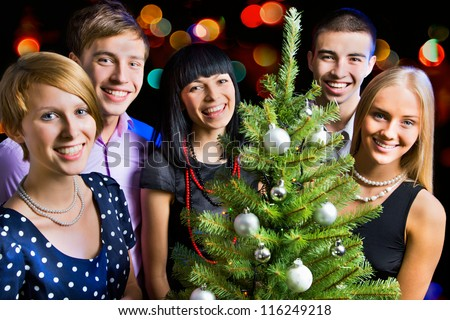 Portrait of several friends celebrating New Year - stock photo