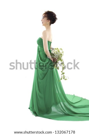 portrait of sexy beautiful bride woman l in green wedding dress with hairstyle - stock photo