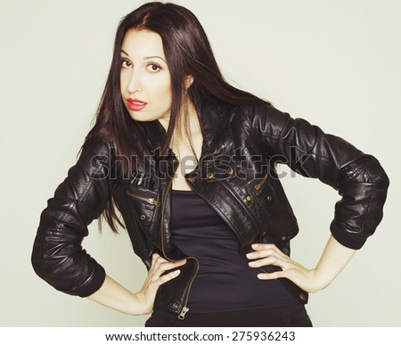 Portrait of sexy beautiful young brunette woman in leather jacket