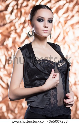 Portrait of sexy brunette posing in black underwear and vest - stock photo