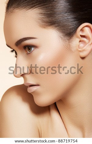 Portrait of sexy caucasian young woman. Natural spa beauty with pure skin. Beautiful model with natural make-up, clean skin on beige background - stock photo