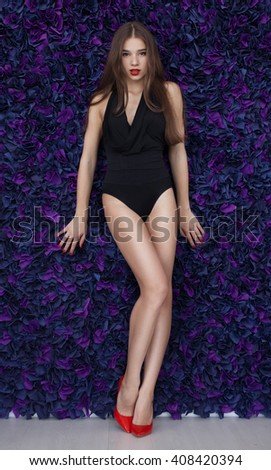 Portrait of sexy fashion model girl on purple. Beautiful lady in elegant black lingerie Beauty brunette woman with attractive buttocks. - stock photo
