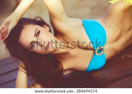 Portrait of sexy fashion model wearing bikini beach series - stock photo