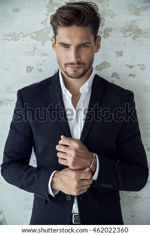 Portrait of sexy man in black suit