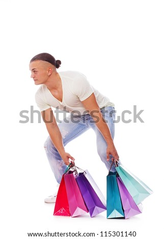 Portrait of sexy man posing in studio with shopping bags - stock photo