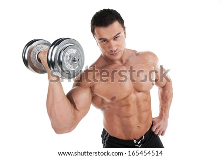 Portrait of sexy muscular man training with dumbbell. Standing isolated over white background