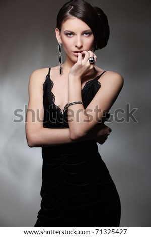 portrait of sexy slim woman in black dress - stock photo