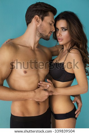 Portrait of sexy undress couple. Young handsome hugging young woman - stock photo
