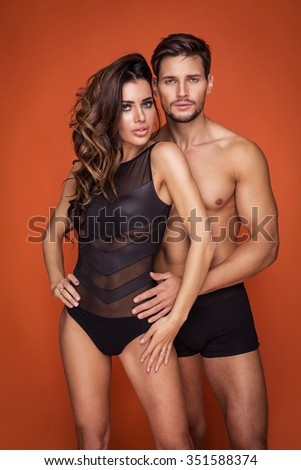 Portrait of sexy undress couple. Young handsome man hugging young woman - stock photo