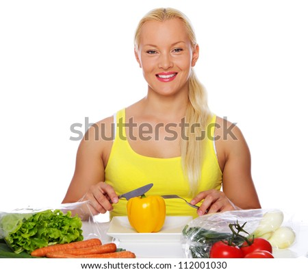 Portrait of sexy woman eating vegetables