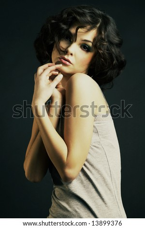 Portrait of sexy woman with beautiful make-up and  curly hair - stock photo