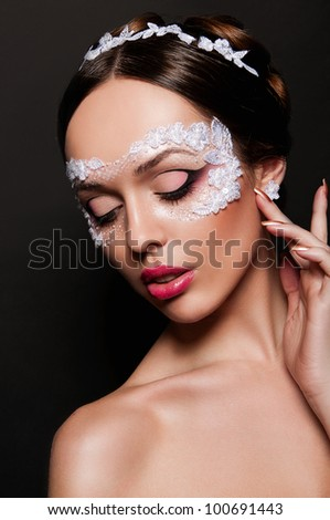 portrait of sexy woman with red lips and mask on face