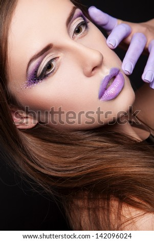 portrait of sexy woman with violet makeup and violet chubby lips