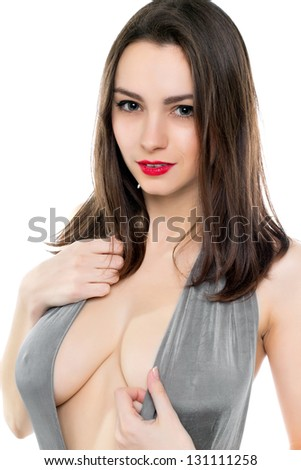 Portrait of sexy young brunette in grey dress with a plunging neckline. Isolated on white - stock photo