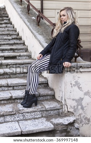 portrait of sexy young stylish smiling woman girl  in modern cloth - stock photo