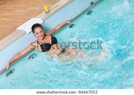 portrait of sexy young woman enjoying the water in jacuzzi - stock photo