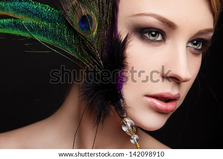 portrait of sexy young woman with peacock